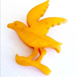 Vintage Carved Butterscotch Bakelite Bird Brooch